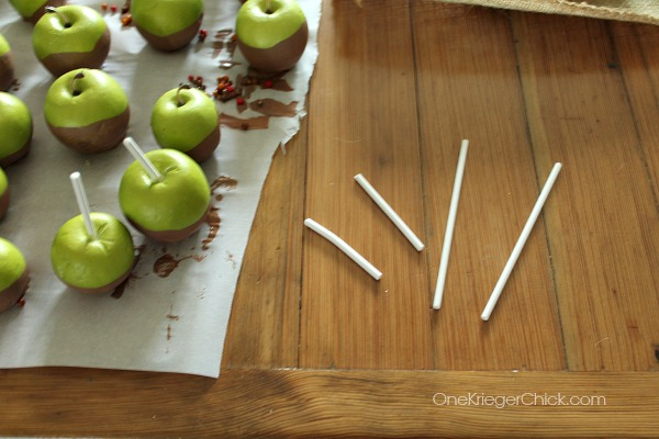 Painted-caramel-apples-adding sticks-OneKriegerChick.com