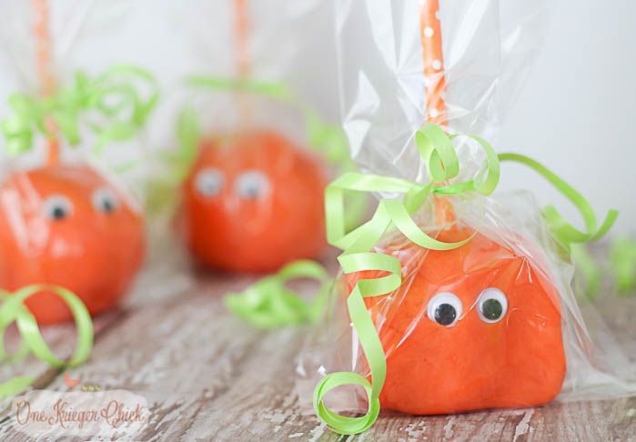 these treat bags were such a huge hit i created another version for my youngest to give away at his pre school halloween partyplaydough pumpkin pops